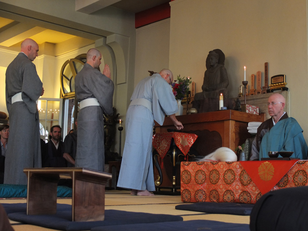The ordinands make an initial offering before taking on their new clothes.