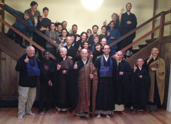 "Participants in the Fall 2014 Practice Period at Green Gulch, raising their fingers in reference to a lecture Reb gave on ""Chu Ti's One-Finger Chan"" (Blue Cliff Record, 19th Case)."