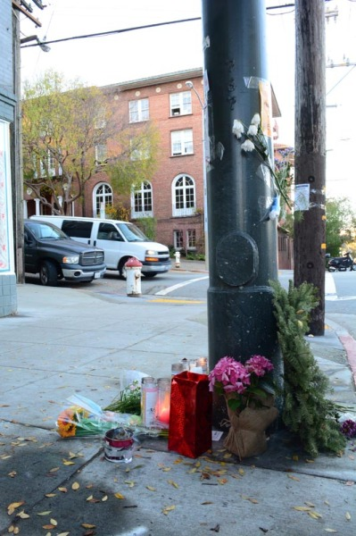 The makeshift memorial site set up across from City Center, near the place where four men were shot in a car double parked on Laguna Street.