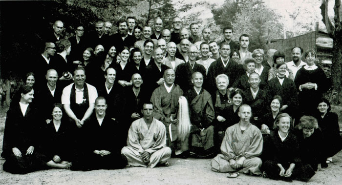 Practice period group at Tassajara with Tatsugami Roshi (center) and Joanna Bull (furthest right, standing).